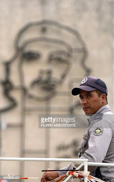 A policeman stands guard in central Havana's Revolution Square a day before Pope Francis' visit to Cuba on September 18 2015 Havana has received a...