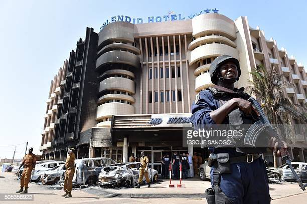 TOPSHOT A policeman stands guard in front of the Splendid hotel on January 17 2016 in Ouagadougou following a jihadist attack by AlQaeda linked...