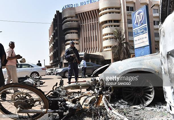 A policeman stands guard in front of the Splendid hotel on January 17 2016 in Ouagadougou following a jihadist attack by AlQaeda linked gunmen late...
