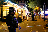 A policeman stands guard near the Boulevard des FillesduCalvaire after an attack November 13 2015 in Paris France Gunfire and explosions in multiple...