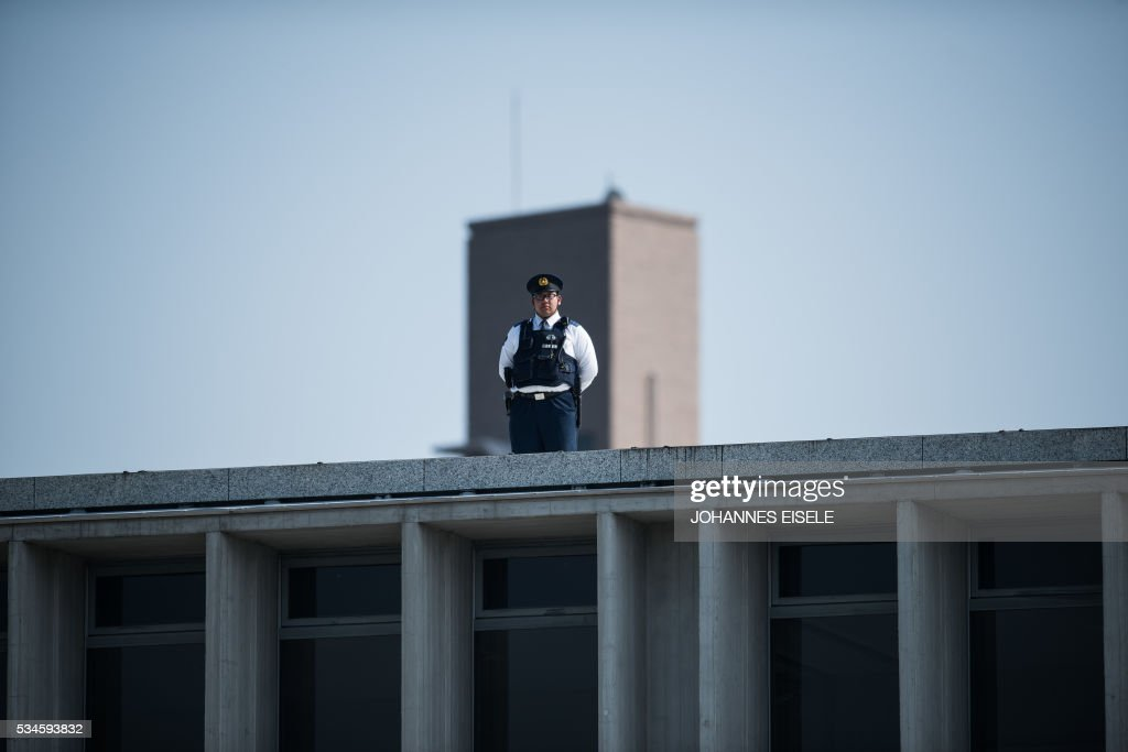 A policeman stands guard on the roof of the museum at the Hiroshima Peace Memorial in Hiroshima on May 27, 2017. US President Barack Obama was to make history later on May 27 when he travels to Hiroshima -- becoming the first sitting US leader to visit the site that ushered in the age of nuclear conflict. / AFP / JOHANNES