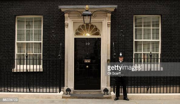 A policeman stands guard outside Number 10 Downing Street on June 5 2009 in London England Prime Minister Gordon Brown is today carrying out a...
