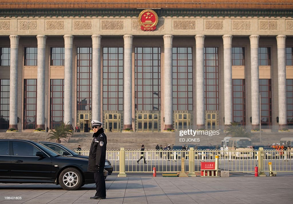 A policeman stands guard outside the Great Hall of the People prior to the unveiling of a new Politburo Standing Committee, in Beijing on November 15, 2012. Xi Jinping is set to take the reins of China's all-powerful Communist Party in a leadership transition that will put him in charge of the world's number two economy for the next decade. AFP PHOTO / Ed Jones