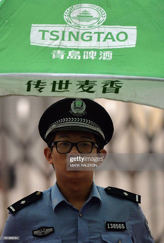 A policeman stands guard outside the Intermediate People's Court on the eve of the sentencing of disgraced politician Bo Xilai in Jinan, Shandong Province on September 21, 2013. The verdict in the case of China's fallen political star Bo Xilai, due on September 22, will cap an extraordinary scandal involving bribes, murder, illicit love, political infighting, and a colourful yet tightly controlled trial. Even before the stunning five-day hearing last month, the downfall of the once-powerful Bo was already the most sensational drama in decades to rock the ruling Communist Party and its prized stability. AFP PHOTO / Mark RALSTON