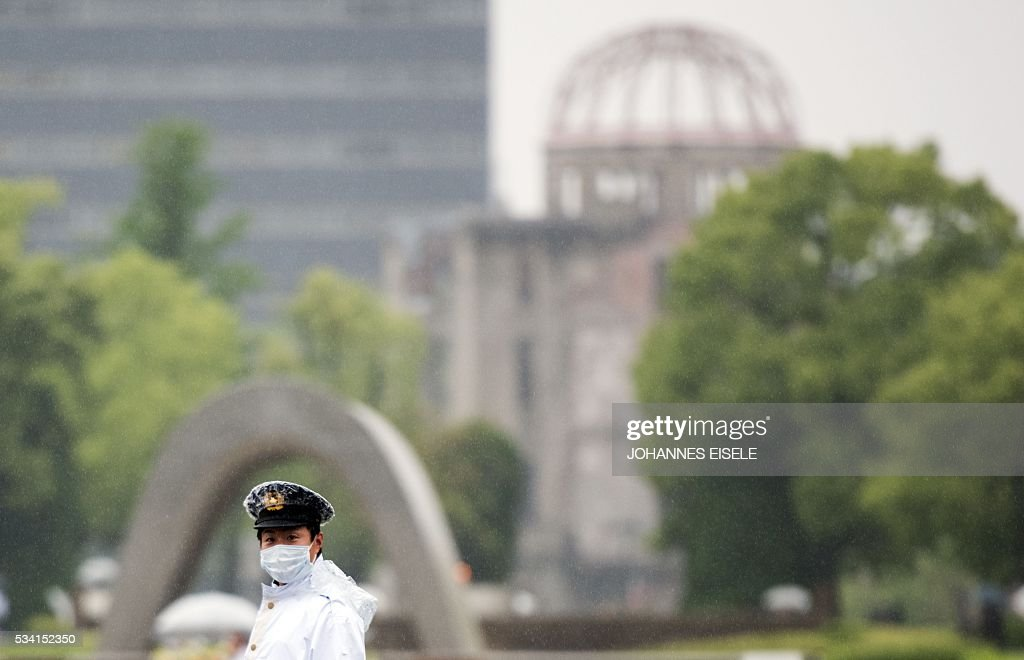 A policeman stands in front of the Peace Memorial Genbaku Dome in the Hiroshima Peace Memorial park in Naka Ward, Hiroshima Prefecture on May 25, 2016. US President Barack Obama is set to become the first sitting US president to visit Hiroshima when he journeys on May 27 with Japanese Prime Minister Shinzo Abe, hallowed ground to Japanese but, for more than 70 years, a no-go zone for 11 of his Oval Office predecessors. / AFP / JOHANNES