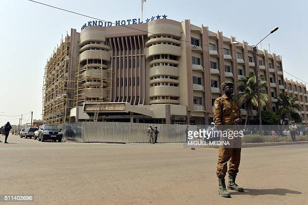 A policeman stands in front of the Splendid hotel in Ouagadougou on February 20 more than a month after a terrorist attack at the hotel and a nearby...