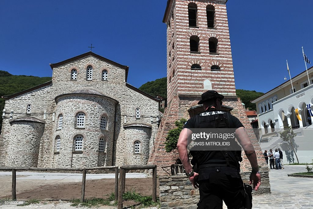 A policeman stands in Karyes near the Mount Athos where Russian President Vladimir Putin will visit, on 28 May, 2016. Russian President is visiting Mount Athos in Greece to mark the 1,000-year presence of Russian Orthodox monks there. Russian President Vladimir Putin signed several economic deals with Athens on on May 27, 2016 during a visit to Greece aimed at reinforcing a relationship with one of his few friends in the EU amid tensions with the West. MITROLIDIS