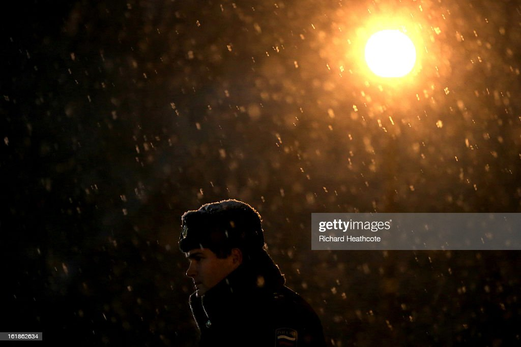 A policeman stands in the snow at the Rosa Khutor Alpine Ski Resort in Krasnaya Polyana on February 17, 2013 in Sochi, Russia. Sochi is preparing for the 2014 Winter Olympics with test events across the venues.