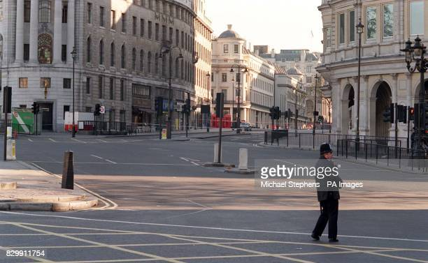 A policeman stands in Trafalgar Square by the entrance to the Strand and Charing Cross railway station after security alerts led to the disruption of...