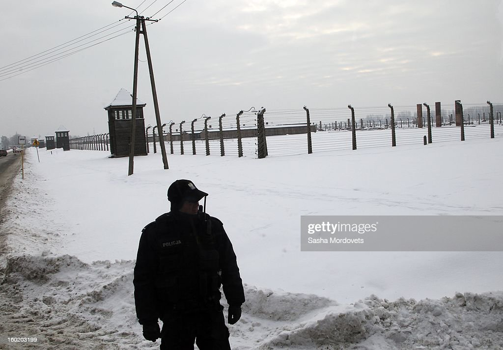 A policeman stands near the gates of the former Auschwitz Birkenau Nazi concentration camp January 27, 2013 near Oswiecim, Poland. A ceremony marked the 68th anniversary of the liberation of the camp during International Holocaust Remembrance Day.