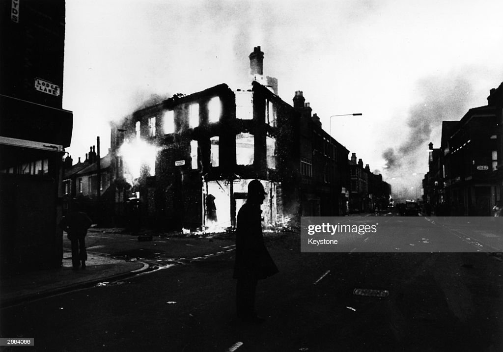 Policeman stands on guard after a night of rioting in Toxteth, Liverpool.