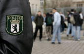 A policeman stands outside Ruetli High School as students leave April 3 2006 in the Neukoelln district in Berlin Germany Teachers from the school...