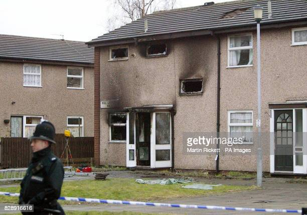 A policeman stands outside the house in Will Griffiths Walk Beswick Manchester where a fire killed three young children and an adult The four bodies...