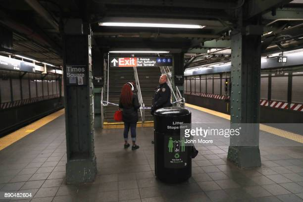 A policeman talks to a subway rider near the site of a pipe bomb explosion on December 11 2017 in New York City Police said that Akayed Ullah a...