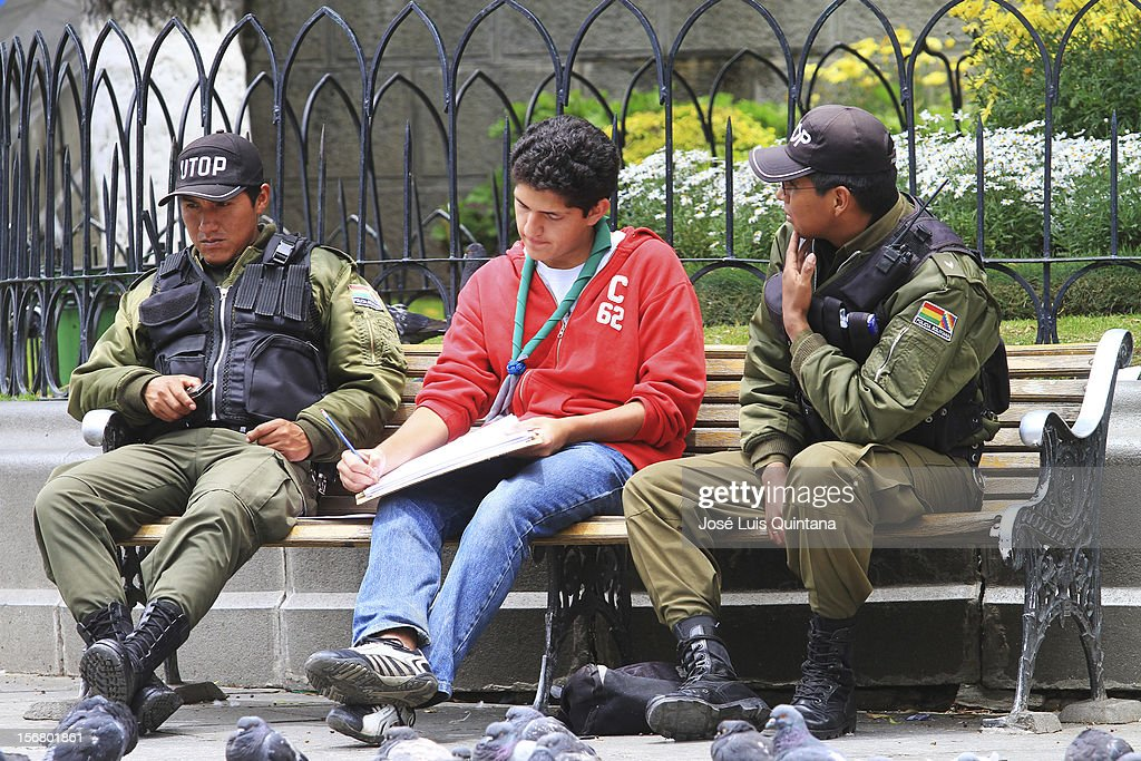 A policeman talks to the enumerator during the bolivian national census on November 21, 2012 in La Paz, Bolivia.