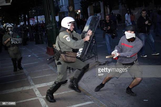 A policeman tries to arrest a demonstrator in central Athens on April 23 2010 Greece appealed for a debt rescue from the EU and IMF on April 23 and...