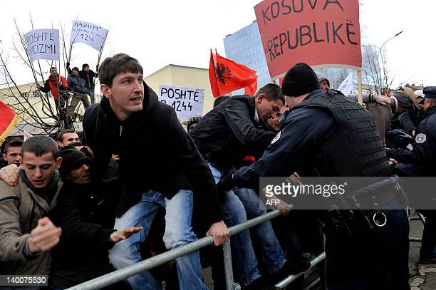 A policeman tries to contain supporters of the hardline ethnic Albanian SelfDetermination movement 'Vetvendosje' that protest in Pristina on February...