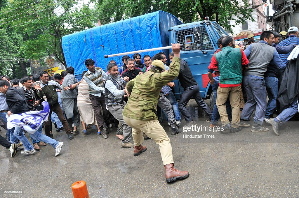 Policeman use baton charge on Public Health Engineering department (PHE) government employees during a protest on May 24, 2016 in Srinagar, India. Police detained dozens of government employees, and resorted to baton charging to disperse the employees during the protest march. The government employees demanded the regularization of contractual jobs and release of salaries.