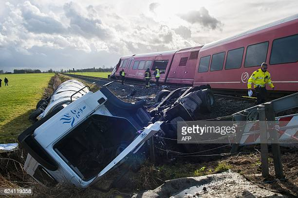 TOPSHOT A policeman walks near a derailed passenger train and a smashed milk tanker after a crash near Winsum on November 18 2016 Several people were...