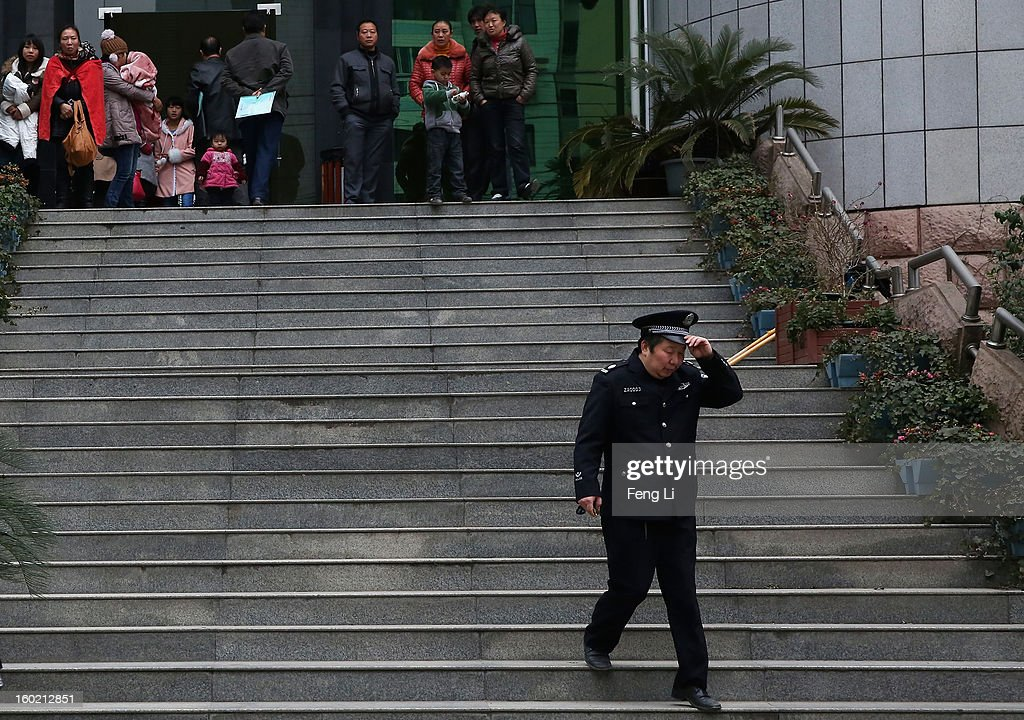 A policeman walks out Guiyang Intermediate People's Court before a press conference on former Chinese leader Bo Xilai's case on January 28, 2013 in Guiyang, China. 'It is fake information. The trial of Bo Xilai will not open in Guiyang today', Vice-president of Guiyang Intermediate People's Court Jiang Hao said. The trial of Bo Xilai is expected to open after the 'two sessions' in March, China's official newspaper Global Times reports on Monday.