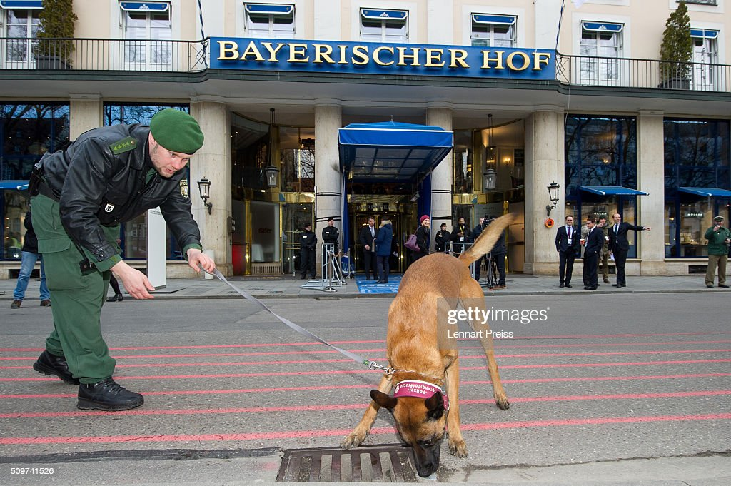 A policeman with a bomb sniffer dog checks the area in front of the Hotel Bayerischer Hof during an official photo opp ahead of the 2016 Munich Security Conference at the Bayerischer Hof hotel on February 12, 2016 in Munich, Germany. The annual event brings together government representatives and security experts from across the globe and this year the conflict in Syria will be the main issue under discussion.