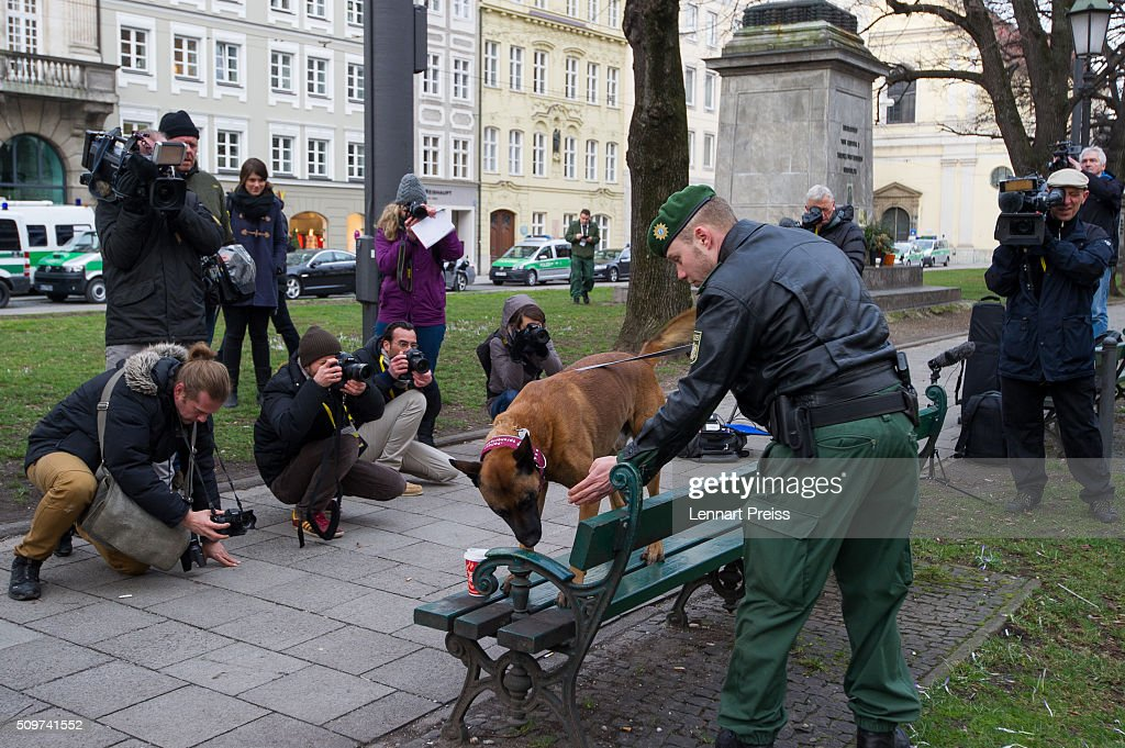 A policeman (R) with a bomb sniffer dog checks the area in front of the Hotel Bayerischer Hof during an official photo opp ahead of the 2016 Munich Security Conference at the Bayerischer Hof hotel on February 12, 2016 in Munich, Germany. The annual event brings together government representatives and security experts from across the globe and this year the conflict in Syria will be the main issue under discussion.