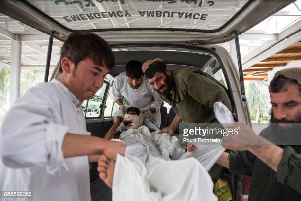 A policeman with a gunshot wound to his face from fighting in Sangin arrives at the emergency room at the Emergency hospital in Lashkah Gar...