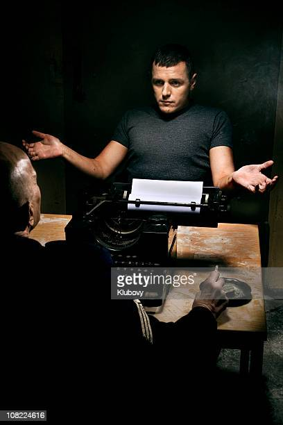 Policeman with Man During Interrogation