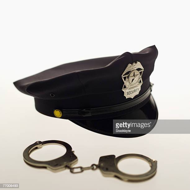 Policeman's hat and handcuffs