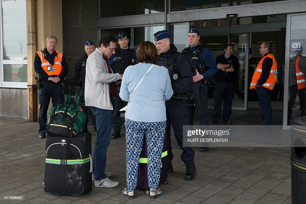 A member of a hong kong police forensic team examines the for Interior zaventem