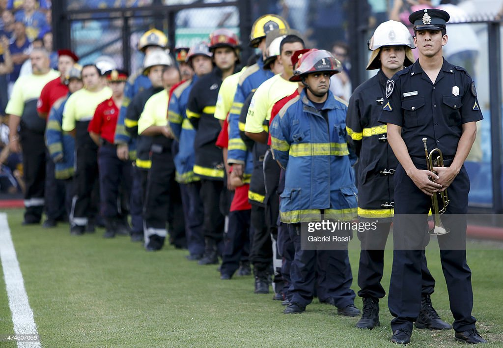 Policemen and Firemen remembering fallen colleagues during a match between Boca Juniors and Estudiantes as part of forth round of Torneo Final 2014 at Estadio Unico de La Plata on February 23, 2014 in La Boca, Buenos Aires, Argentina.
