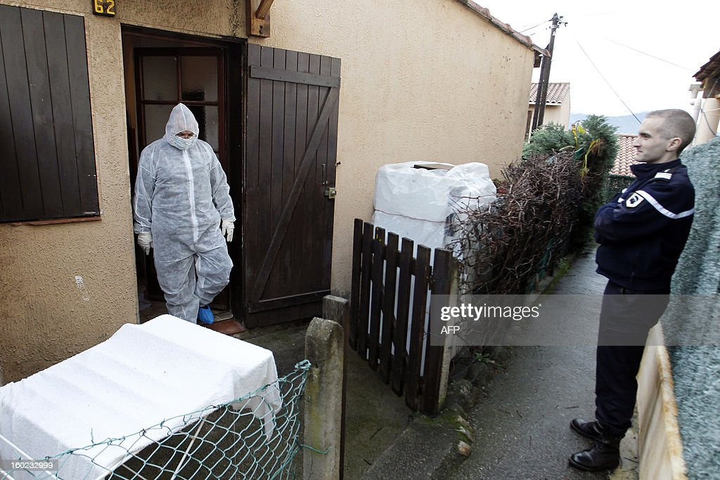 Policemen and forensics investigate around a crime scene, on January 28, 2013, close from Agosta beach in Albitreccia, in the French Mediterranean island of Corsica. A Tunisian-born man, Assen Jamaio, was found dead today in his home probably stabbed to death according to the police. AFP PHOTO / PASCAL POCHARD-CASABIANCA