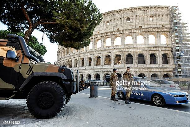 Policemen and Italian soldiers patrol in front of the Colosseum on November 19 2015 in Rome Italy has increased security at its historic monuments in...