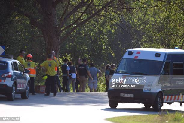 Policemen and medical staff stand at the site where Moroccan suspect Younes Abouyaaqoub was shot on August 21 2017 near Sant Sadurni d'Anoia south of...