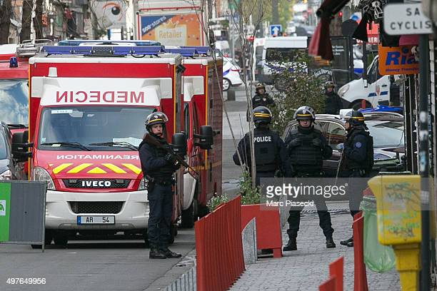 Policemen and medical vehicles are seen on 'Rue Gabriel Peri' on November 18 2015 in SaintDenis France French Police special forces raided an...