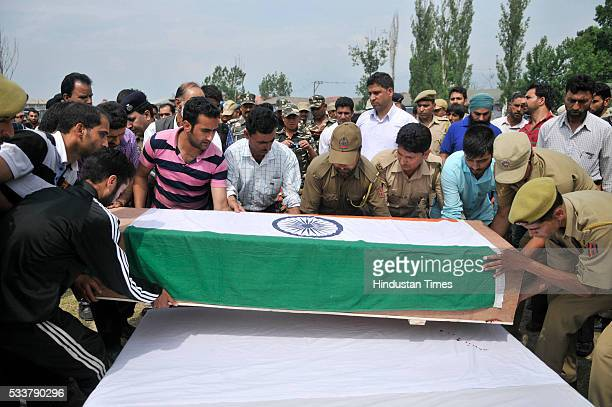 Policemen and relatives carry the coffin of one of the policemen killed in terror attack during a wreath laying ceremony at Police Control Room on...