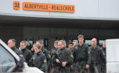 Policemen are seen at the AlbertvilleSchool Centre on March 11 2009 in Winnenden near Stuttgart Germany According to media reports a gunman attacked...