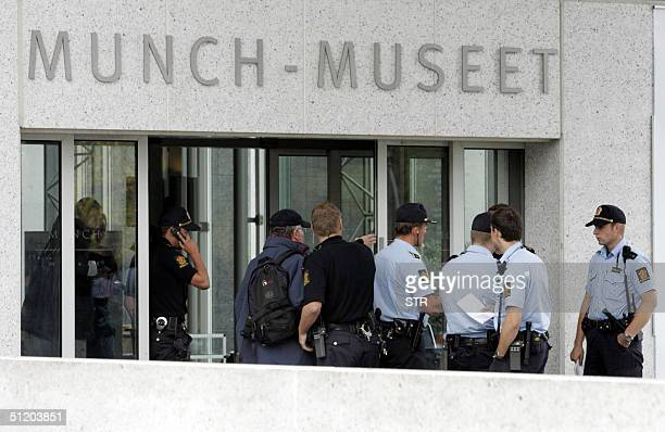 Policemen are seen in front of the Munch Museum in Oslo as they investigate the robbery of several Edvard Munch paintings 22 August 2004 Edvard...