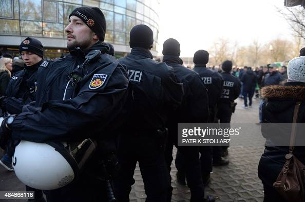 Policemen are seen in front of the stadium prior to the German first division Bundesliga football match SV Werder Bremen vs VfL Wolfsburg in Bremen...