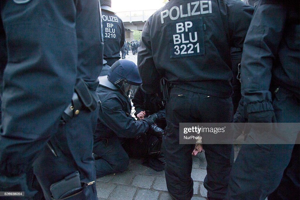 Policemen arrest a demonstrator during the clashes occurred in the Kreuzberg district on May 1, 2016 in Berlin, Germany. May Day, or International Workers' Day, was established as a public holiday in Germany in 1933. Since 1987 May Day has also become known in Berlin for violent clashes between police and mostly left-wing demonstrators.