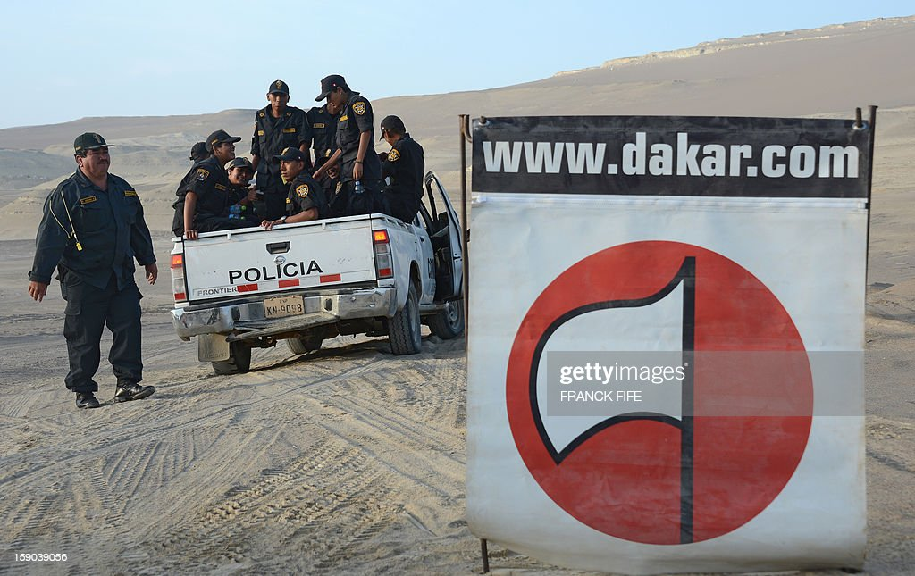 Policemen arrive before the start of the Stage 2 of the Dakar 2013 in Pisco, Peru, on January 6, 2013. The rally will take place in Peru, Argentina and Chile from January 5 to 20. AFP PHOTO / FRANCK FIFE