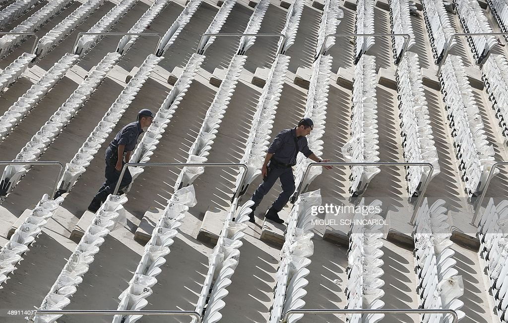 Policemen at the Arena Corinthians stadium on May 10, 2014 in Sao Paulo, Brazil. The Arena Corinthians will host the opening match of the FIFA World Cup Brazil 2014 between Brazil and Croatia on June 12. AFP PHOTO/Miguel SCHINCARIOL