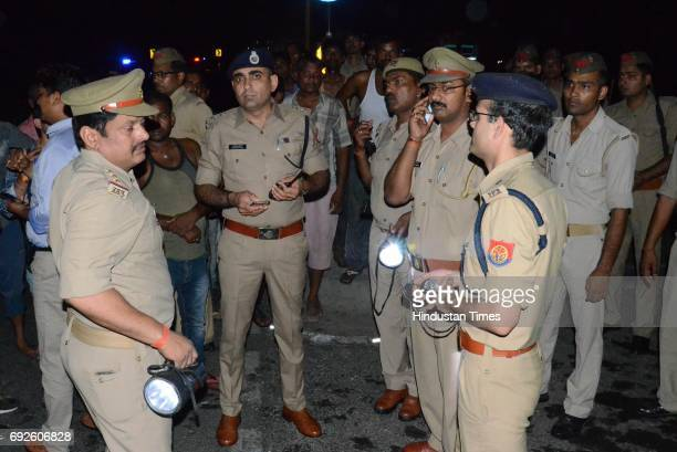 Policemen at the spot where bus caught fire after the collision with truck near the Bareilly bypass on June 5 2017 in Bareilly India Twentytwo people...