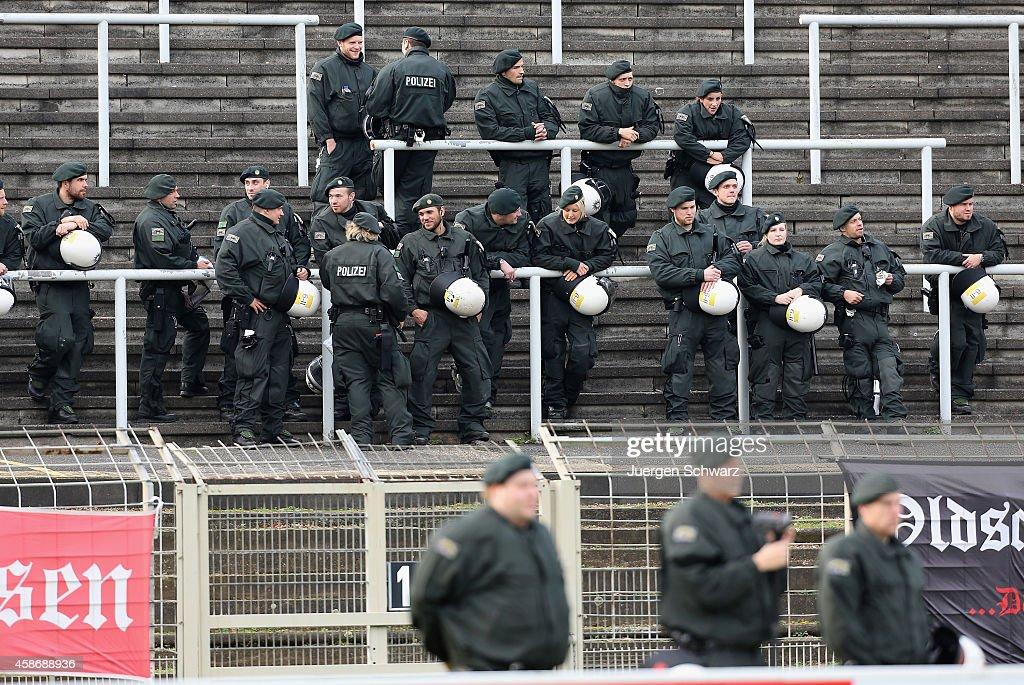 Policemen attend the Regionalliga West match between KFC Uerdingen and Rot-Weiss Essen on November 9, 2014 in Krefeld, Germany.
