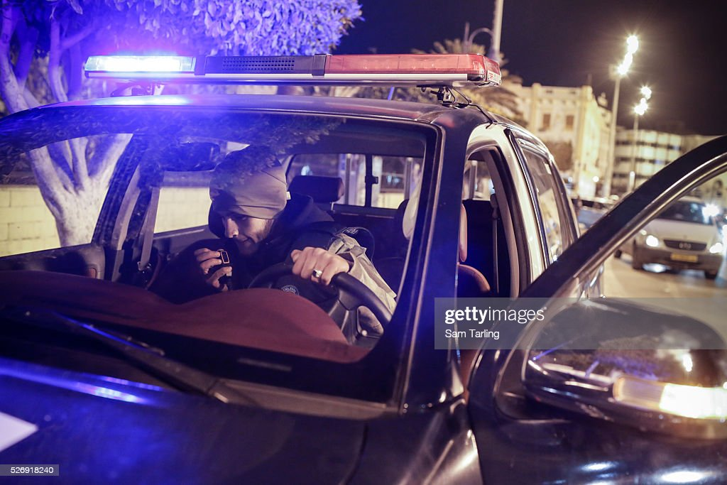 Policemen belonging to the Nawasi brigade which is part of the Tripolibased Libyan General National Congress government's Interior Ministry conduct...