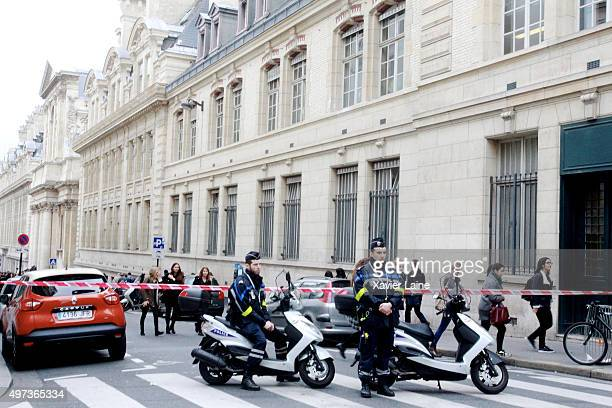 Policemen block a road near to Sorbonne University in the 5th Arrondissement as people nearby gather to observe a minutesilence in memory of the...