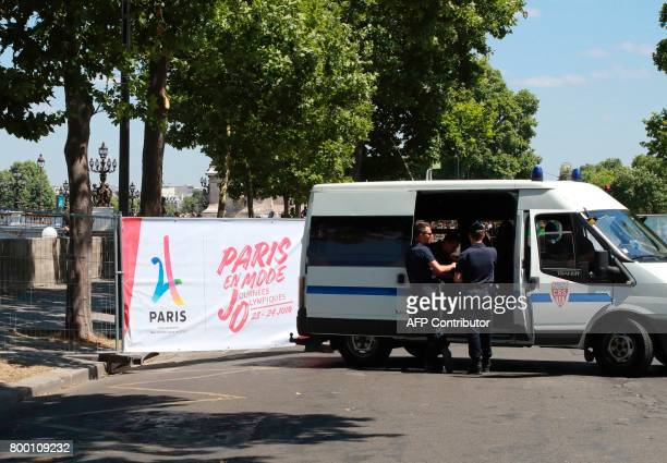 Policemen block access in Paris on June 23 during an event to promote the candidacy of the city of Paris for the Summer Olympics Games in 2024...