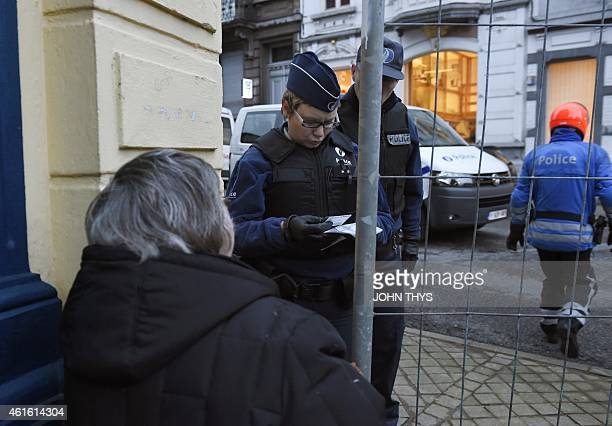 Policemen block Colline street in Verviers eastern Belgium on January 16 after police shot dead two suspects in a gun battle after they opened fire...