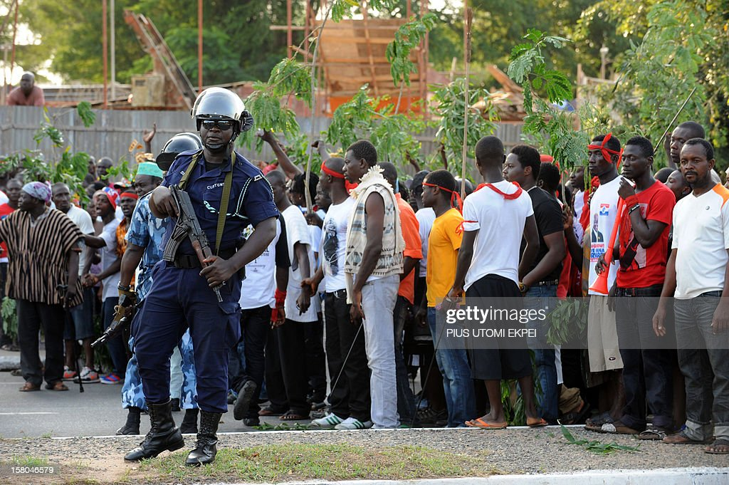 Policemen block supporters of the opposition New Patriotic Party from as they march to Electoral Commission's headquaters to protest against the...