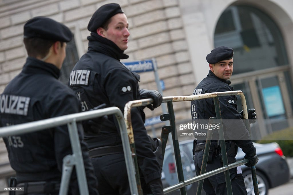 Policemen carry a barrier ahead of the 2016 Munich Security Conference at the Bayerischer Hof hotel on February 12, 2016 in Munich, Germany. The annual event brings together government representatives and security experts from across the globe and this year the conflict in Syria will be the main issue under discussion.